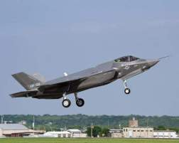 Japan wants to buy 42 F-35 joint strike fighters, but the former defense minister believes the annual purchase rate could go down. Here, the seventh Lockheed Martin F-35 takes its first flight in April. (Lockheed Martin)